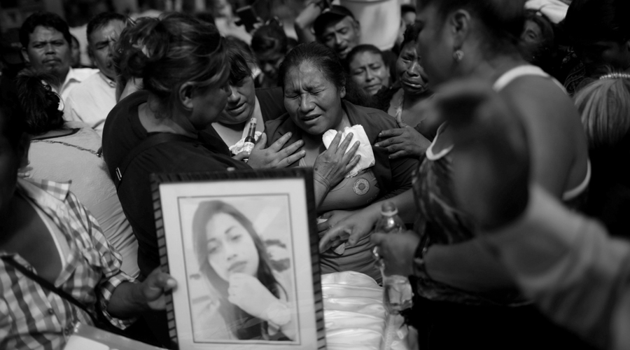 A woman cries during the funeral of Siona Hernandez, a victim of a fire at the Virgen de Asuncion children shelter, at the cemetery in Guatemala City